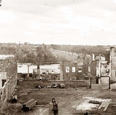 Richmond, Virginia  Ruins of Richmond & Petersburg Railroad bridge; south bank of the James beyond.  It was made in 1865 by Gardner, Alexander