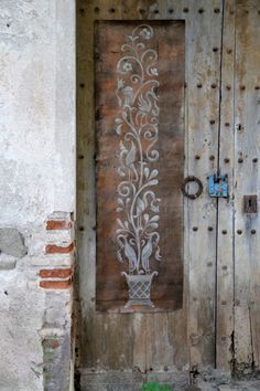 Decorate an old outdoor shed exterior with a stencil pattern panel