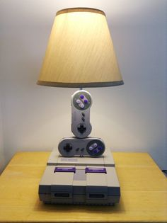 Reserved for Kayt: This is a very unique lamp sculpture I made using a Super NES console and 2 controllers. The system and the controllers no