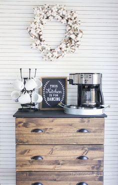 I can't even believe what this kitchen looked like before! I love this DIY skinnylap wall and farmhouse style coffee bar.