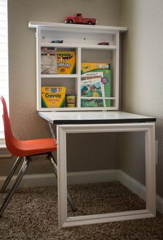 This space saving activity center for children features a chalkboard that folds down and becomes a table top. Interior shelves provide storage