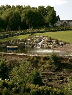 A gorgeous and functional swimmable pond provides a fun retreat for this Minnesota family.