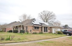 Ugly Solar Panels facing the street going up in Baton Rouge.  This home looks like space ship