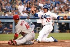 Miguel Rojas of the Los Angeles Dodgers is out at home plate in the second inning against Carlos Martinez, Cards won 3-1. 6-27-14
