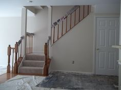This is the view of the stairwell located on the main level. Job Pictures, Townhouse Interior, Interior Painting, Stairs, Home Decor, Stairway, Decoration Home, Staircases, Room Decor