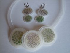 translucent polymer clay is used in this necklace and earring set by Florence Belliard