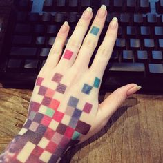 Pixelated Multicolor Hand Tattoo http://www.pairodicetattoos.com/pixelated-hand-tattoo/