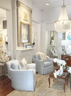 Beautiful vignette by Rivers Spencer in her New Orleans shop. Love the lines on the club chairs and the trumeau mirro