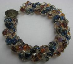 Boro and Macrame Bracelet in neutrals and blues by Cheryl Erickson.  Instructions and kits available in this and other colors from www.artisticbead.com