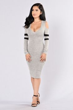- Available in Grey - Fitted Dress - Knee Length - Cold Shoulder - V Neckline - Long Sleeve - Striped Arm Detail - Made in USA - 77% Rayon 18% Polyester 5% Spandex