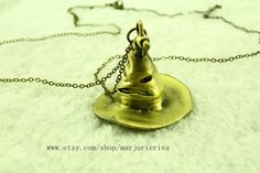 the bronze sorting hat necklace hogwarts....could this be turned into tree ornament?