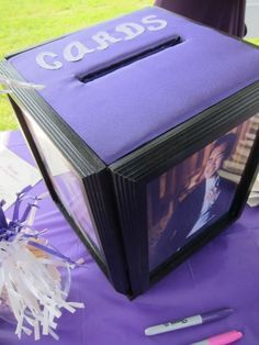 Neat DIY card box, the pictures around the box are in photo frames just not sure…