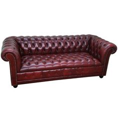 Image of British Oxblood Leather Tufted Chesterfield Sofa