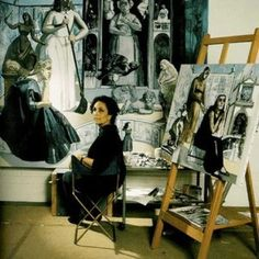 Paula Rego in front of her painting.