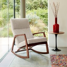 This mid-century American classic design inspired rocking chair incorporates an elegant and simple solid wood frame with a generously upholstered seat.