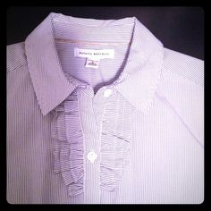 Banana Republic Fitted Button Down Shirt Ruffle detail at front.  White shirt with grey pinstripes.  Looks great tucked into a pencil skirt or pants.  96%cotton 4% spandex adds a little stretch.  This is from the BR store - NOT the outlet.  Excellent condition and has been dry cleaned.  No trades. Banana Republic Tops Button Down Shirts