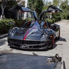 "Pagani Huayra ""Project Vulcan"" made out of exposed Carbon Fiber w/ red accents and Wheels Photo taken by: @justinkonda on Instagram (@brett_david on Instagram is the owner of the car)"