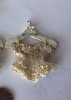 Handmade 1:12th Scale DollHouse Miniature Corset -Ladies Victorian style Cream bows Cream Lace Corset on coutellerie advert Hanger by Miniaturefrills on Etsy https://www.etsy.com/uk/listing/549263107/handmade-112th-scale-dollhouse-miniature