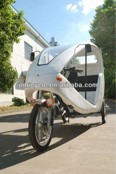Green power pedal operated electric tricycle