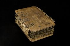 Icelandic binding of wood, one cover of beech and the other of oak, with decorative carving, a leather spine and visible binding structure, 15th century.