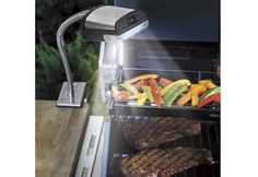 Cook perfectly grilled steaks ribs and burgers even at night cordless outdoor grill light sharper image mozeypictures Image collections