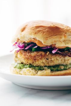 Recipe for Spicy Cauliflower Burgers with avocado sauce, cilantro lime slaw, and chipotle mayo! Meatless and delicious. | pinchofyum.com