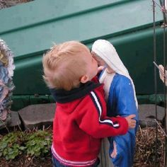 Mary receives a kiss from one of her children