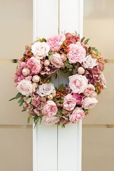 Would like better in blush & white tones -  37 Fresh Spring Wedding Wreaths | HappyWedd.com