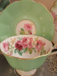 Royal Albert vintage green teacup with pink roses.                                          Too pretty! Love the colors!