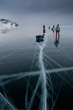 Skating on iced Baikal lake (Siberia)