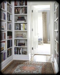 Even better, build a bookcase around the door at the end of the hallway to create a hidden door and give the hallway the feel of being its own room.