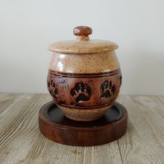 gold paw print pet urn