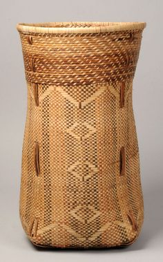 Africa | Basket from the Yaka people of DR Congo | Vegetal fiber; decorated with geometric motives of red and cream