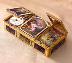 • the central lid enameled with scene of a young boy and girl picking cherries, flanked by panels painted with flowers in marble vases, the scenes form a pearl-set arcade • the left cover opening to reveal a rectangular enameled panel with time dial below an oval vignette of a boy mounted on an ox • the conforming movement with verge and fusee • the right lid revealingthe four color gold and enamel automaton scene driven by pinned disc musical movement,comprising a woman playing a…