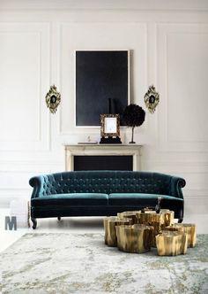 living rooms - wall trim, wall moldings, art over fireplace, fireplace art, marble fireplace, velvet sofa, tufted sofa, peacock blue sofa, b...