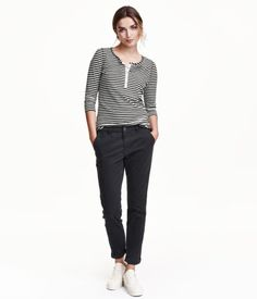 Chinos in washed, stretch cotton twill with a regular waist. Diagonal side pockets, welt back pockets, and tapered legs.
