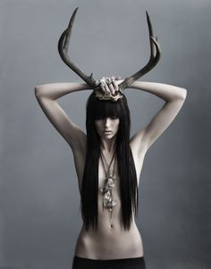 Love her hair!  Ummm...  the antlers?  Hahahahahaha!  Yah, we all need those!