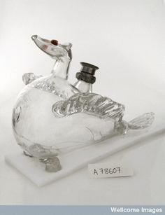 Glass infant's feeding bottle with three legs. 18th century, L0036746 Credit: Wellcome Library, London