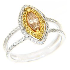 Brides.com: Engagement Rings with Colored Stones. Style 15898, 18K white and yellow gold ring with 0.52 carat round brilliant, 0.09 carat yellow and 0.43 carat center diamonds, $6,880, Michael John Jewelry  See more yellow gold engagement rings.