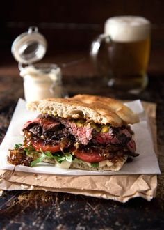 A juicy Steak Sandwich loaded with tender slices of steak, caramelised onion, garlic aioli, lettuce, tomato and mustard. recipes for two recipes fry recipes Yummy Recipes, Beef Recipes, Cooking Recipes, Leftover Steak Recipes, Vegan Recipes, Dinner For One, Steak Sandwich Recipes, Steak Sandwich Sauce, Sandwich Ideas