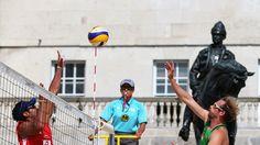 Volleyball - Jonathan Erdmann of Germany is blocked by Igor Hernandez Colina of Venezuela