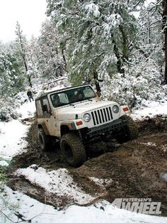 Jeeps in the mud and snow