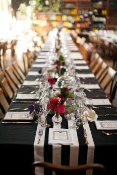 dark tablecloth   mason jars and lots of candles large white paper? flowers