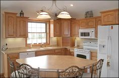 """This layout is exactly our kitchen.  All of our cupboards are the same height, and there is a little bump out over the sink, but the cupboards and appliance placements are practically identical.  Where they have an island, we have a table.  I wish this was a """"before"""" to see what the did.  But this is their """"after""""."""