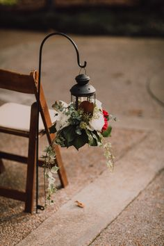 Black lantern with red and white florals and greenery. Wedding Aisle Decorations, Wedding Reception Venues, Wedding Rehearsal, Event Venues, Table Decorations, Aisle Markers, Black Lantern, Anniversary Dinner, Nashville Wedding