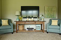 Entertainment Console.....great way to make the tv blend into the decorations.   Just a Girl Blog . August 2012