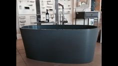 """coco blu∙stone™ freestanding bathtub on display at @ardentesupplywa   Ideally proportioned for smaller spaces such as condo bathrooms, this compact 59"""" tub offers deep-soak capacity with a small footprint - holding an impressive 79G!"""