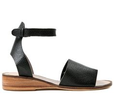 Although simple in design, Fifa sandal retains all the quality you would expect from H London. A soft black leather strap runs across the foot, whilst a second strap with a buckle around the ankle has been added for a comfortable fit. Finished on a leather sole with an added wedge for that extra height. Match with any shorts or skirt for a relaxed summer feel.