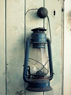 Purchase and use a real lantern.  Image from a beach cottage.  (Subsequently accomplished).