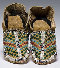 native american, America, Cheyenne beaded hide moccasins, sinew-sewn elk hide using glass bead colors of faceted red white-heart, light blue, translucent green, cobalt, and white; checkerboard design on vamp; hint of yellow pigment on hide, late 19th century.